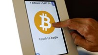 A bitcoin ATM machine is shown at a restaurant in San Diego, California September 18, 2014.