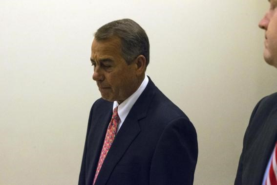 U.S. House Speaker John Boehner (R-OH) departs following a news conference at the U.S. Capitol in Washington December 11, 2014.
