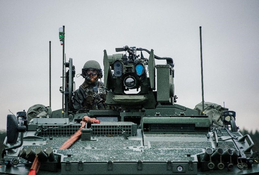 A soldier from the Swedish Armed Forces, looks on from top of a Patria XA-360 AMV at Hagshult Airbase near Malmo on November 6, 2014