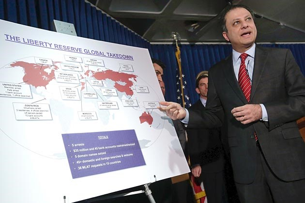 Preet Bharara, U.S. Attorney for the Southern District of New York, explains a chart outlining Liberty Reserve's global interests in a press conference in May 2013