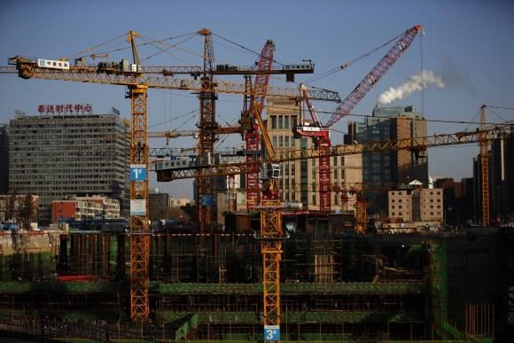 Cranes are seen at a construction site in Beijing December 12, 2014.