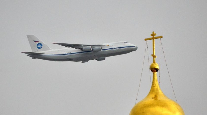 A Russian Antonov An-124 Ruslan strategic airlift jet aircraft flies above the Kremlin's cathedrals in Moscow, on May 7, 2014, during a rehearsal of the Victory Day parade