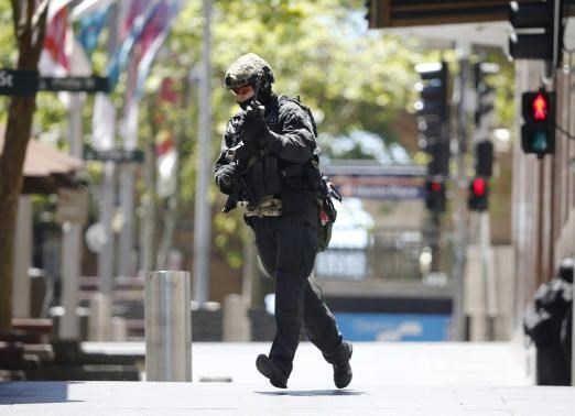 Hostages held in Sydney cafe, forced to hold Islamic flag in window
