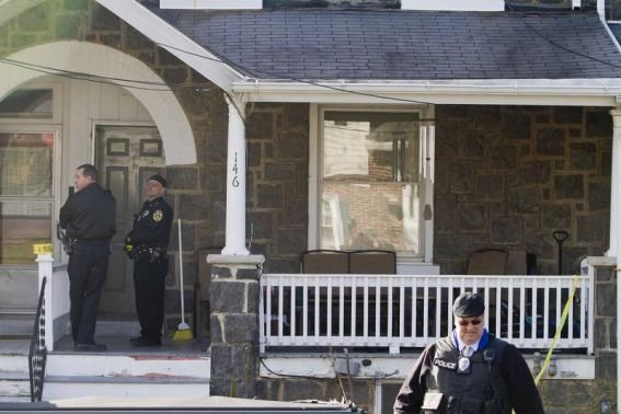 Police search outside a home in a suburb of Philadelphia where a suspect in five killings was believed to be barricaded in Souderton, Pennsylvania, December 15, 2014.