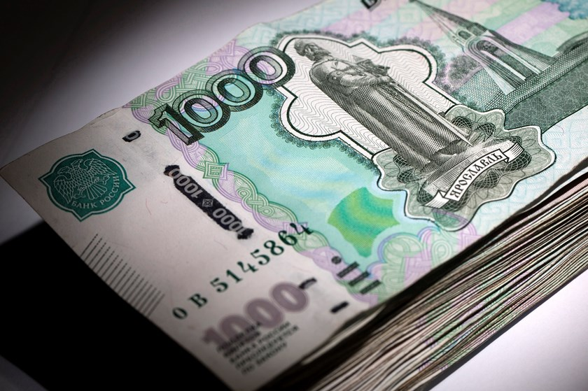 A stack of Russian 1000 ruble banknotes.