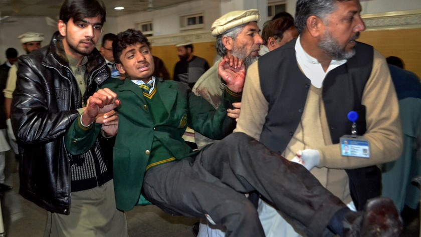 A student injured in the shootout at a school under attack by Taliban gunmen is rushed to a hospital in Peshawar, Pakistan, on Dec. 16, 2014.