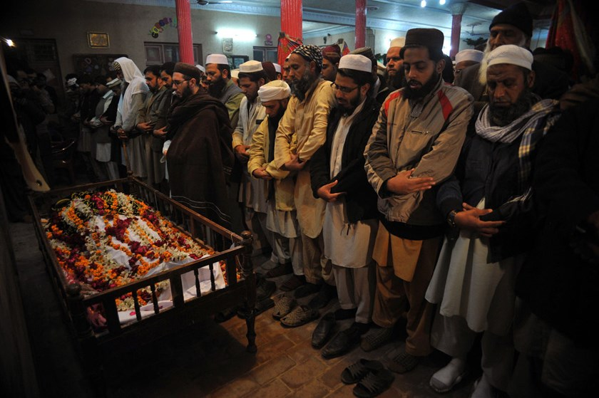 Pakistani mourners pray during the funeral of a student following an attack by Taliban gunmen on a school in Peshawar, on Dec. 16, 2014.