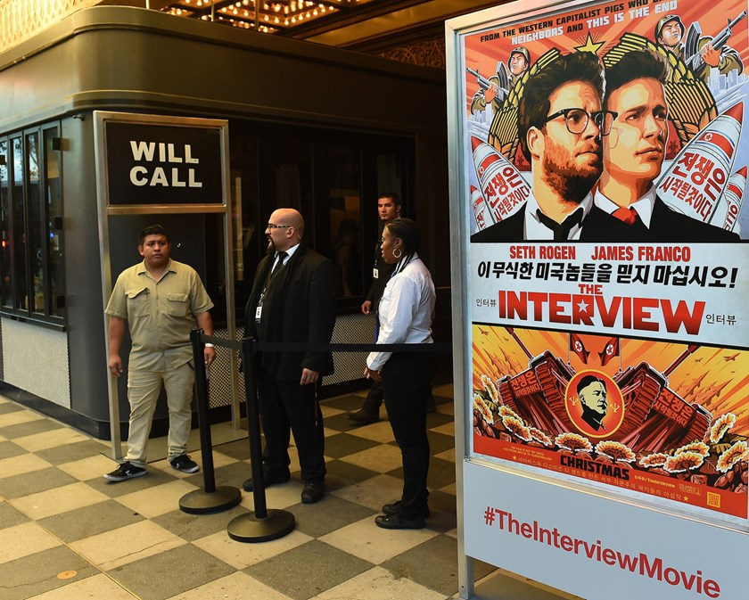 "Security is seen outside The Theatre at Ace Hotel before the premiere of the film ""The Interview"" in Los Angeles, California on Dec. 11, 2014. Sony Corp.'s Culver City, California-based studio today canceled the planned Dec. 25 release, after several majo"