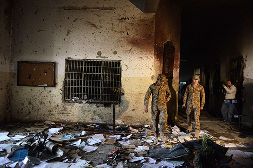 Pakistani soldiers walks amidst the debris in a school a day after an attack by Taliban militants in Peshawar on Dec. 17.