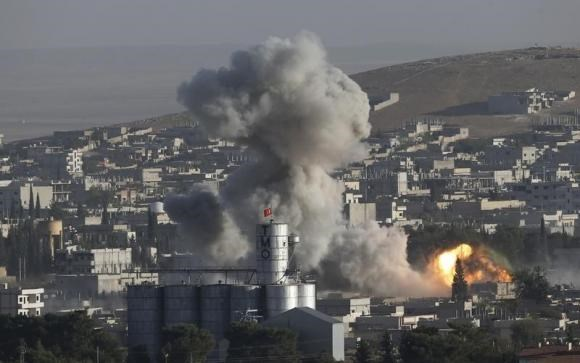 Smoke rises after an U.S.-led air strike in the Syrian town of Kobani Ocotber 10, 2014.