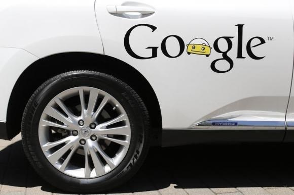 A Google self-driving vehicle is parked at the Computer History Museum after a presentation in Mountain View, California May 13, 2014.