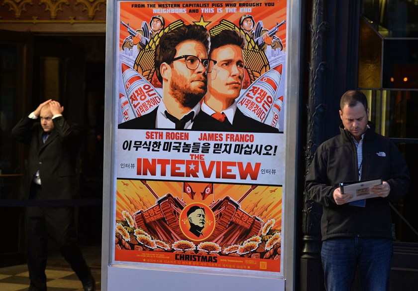 "Security is seen outside The Theatre at Ace Hotel before the premiere of the film ""The Interview"" in Los Angeles, California on Dec. 11, 2014."