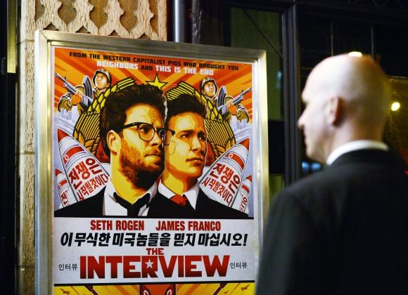 A security guard stands at the entrance of United Artists theater during the premiere of the film ''The Interview'' in Los Angeles, California December 11, 2014.