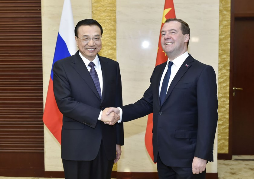 Chinese Premier Li Keqiang, left, shakes hands with Russian Prime Minister Dmitry Medvedev in Astana, Kazakhstan on Dec. 15, 2014.