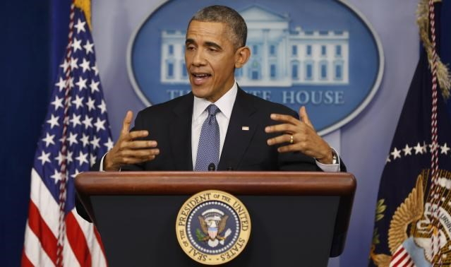 U.S. President Barack Obama responds to a question after his end of the year press conference in the briefing room of the White House in Washington, December 19, 2014.
