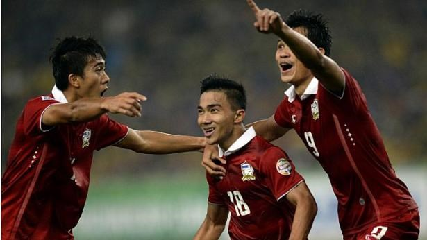 Thailand's Chanathip Songkrasin (middle) celebrates after scoring a goal against Malaysia during their AFF Suzuki Cup 2014 second-leg Final football match at the Bukit Jalil Stadium in Kuala Lumpur on Dec 20, 2014.