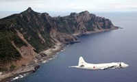 This photo taken on Oct. 13, 2011 shows a P-3C patrol plane of Japanese Maritime Self-Defense Force flying over the disputed islets known as the Senkaku islands in Japan and Diaoyu islands in China, in the East China Sea.