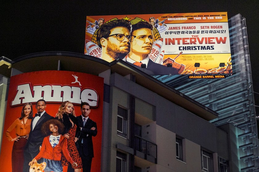 "In this Wednesday, Dec. 17, 2014 file photo, a banner for ""The Interview"" is posted outside Arclight Cinemas in the Hollywood section of Los Angeles."