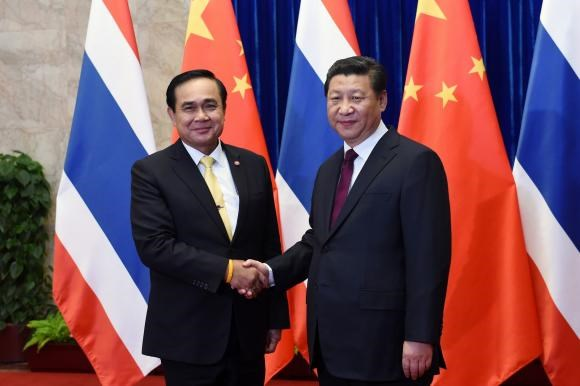 Thailand's Prime Minister Prayuth Chan-ocha (L) shakes hands with China's President Xi Jinping before a meeting at the Great Hall of the People in Beijing December 23, 2014.