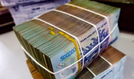 Vietnam plans faster lending in 2015 to spur growth