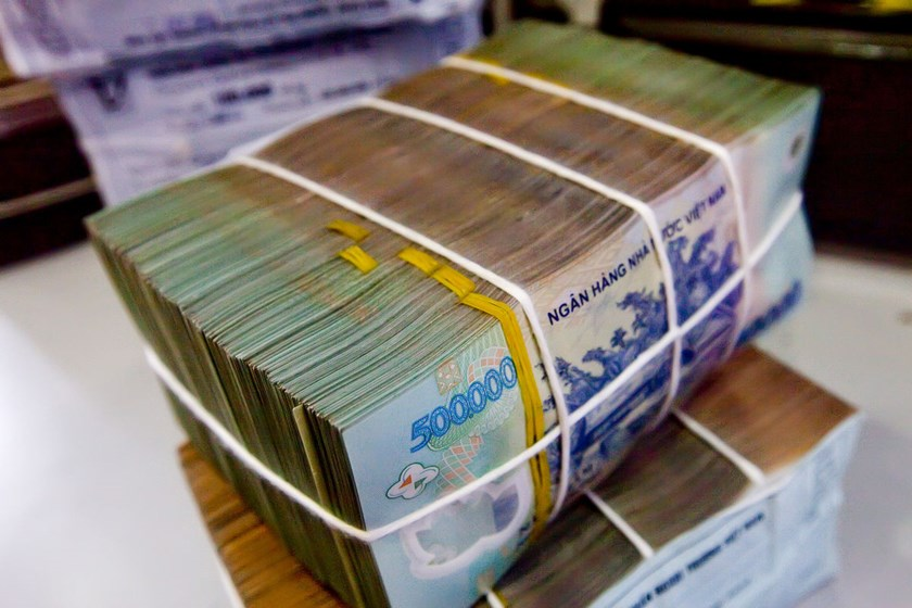 Bundles of dong bank notes are seen in Hanoi, Vietnam.
