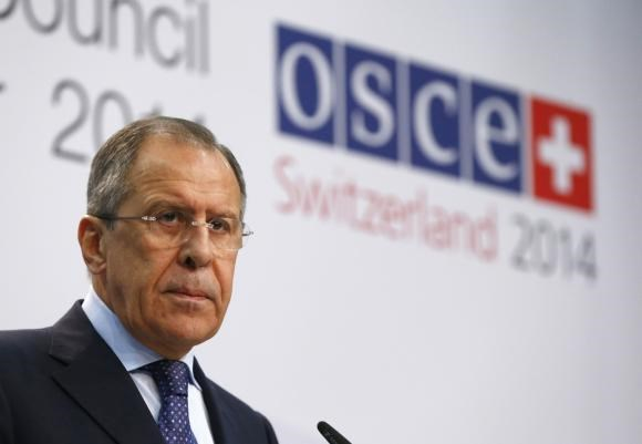Russia's Foreign Minister Sergei Lavrov speaks to media in a news conference during a meeting of foreign ministers from the Organization for Security and Cooperation in Europe (OSCE) in Basel December 5, 2014.