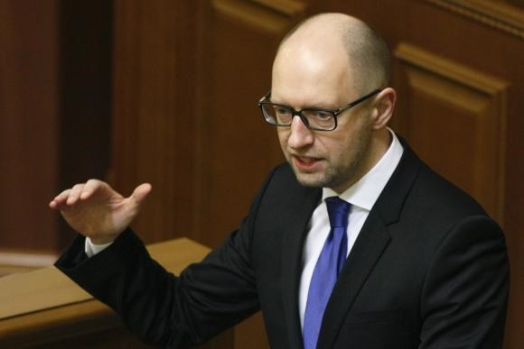 Ukraine's Prime Minister Arseny Yatseniuk speaks to deputies as he presents a work plan of his government during a parliament session in Kiev, December 11, 2014.