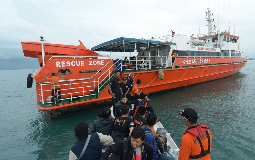 Members of an Indonesian search and rescue team prepare to set off to search at sea for missing AirAsia flight QZ8501 from Manggar in East Belitung on Dec. 30, 2014.