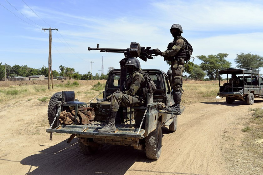 Cameroonian soldiers patrol in Amchide, northern Cameroon, 1 km from Nigeria, on Nov. 12, 2014.
