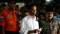 Joko Widodo speaks during a news conference at the AirAsia Crisis center