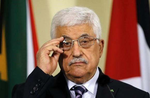 Palestinian President Mahmoud Abbas listens to a question during a media briefing at the Union Building in Pretoria November 26, 2014.