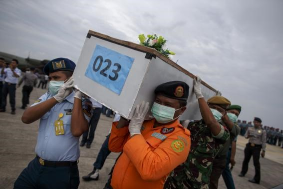 Indonesian military personnel carry the coffin of AirAsia QZ8501 flight attendant Khairunisa Binti Haidar Fauzi at Bhayankara Hospital in Surabaya January 2, 2015.