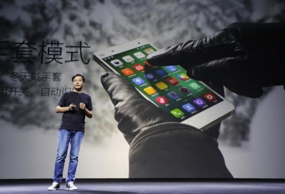 Lei Jun, founder and chief executive officer of China's mobile company Xiaomi Inc, introduces the new features of Xiaomi Phone 4 at its launching ceremony, in Beijing, July 22, 2014.