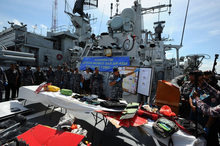 Indonesian Navy personnel show recovered parts of the aircraft AirAsia QZ8501 on board the KRI Bung Tomo ship in Surabaya, Indonesia, on Jan. 5, 2015.