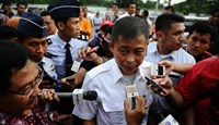 Ignasius Jonan, Indonesia's Minister of Transportation, speaks to journalist after press conference on search efforts for missing AirAsia flight QZ8501 at the crisis centre of Juanda International Airport Surabaya in Surabaya, Indonesia, on Dec. 29, 2014