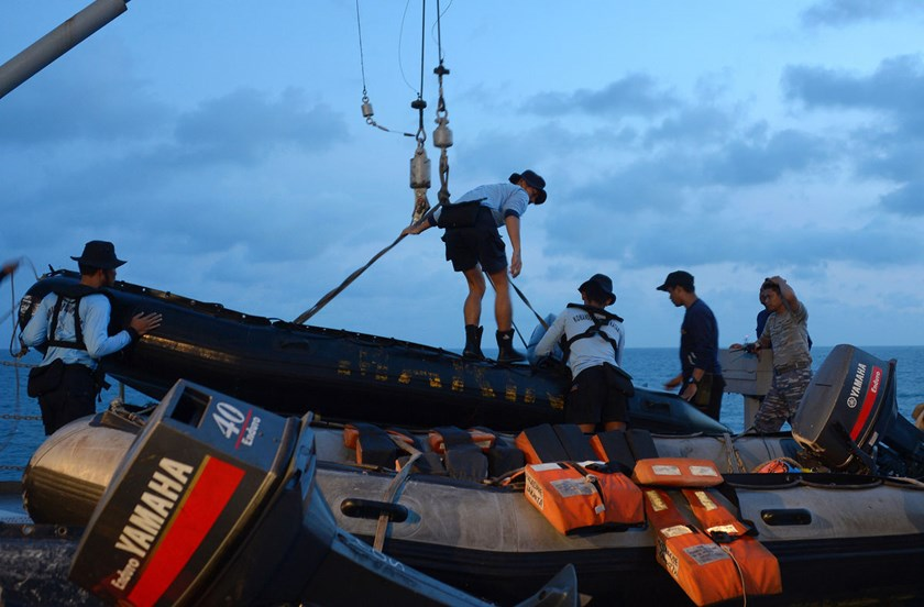Members of the Indonesian Navy prepare equipment to be lowered into the water from the vessel KRI Banda Aceh to conduct operations to lift the tail of AirAsia flight QZ8501 in the Java Sea on Jan. 9, 2015.