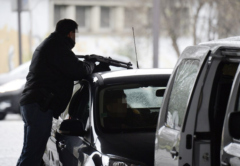 A police officer mans a position at the Porte de la Villette road hub in Paris on January 8, 2015 after a policewoman was killed and a city employee seriously hurt when a man opened fire with an automatic rifle outside Paris today.
