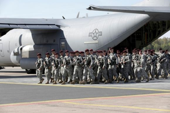 First company-sized contingent of about 150 U.S. paratroopers from the U.S. Army's 173rd Infantry Brigade Combat Team based in Italy arrive in the airport in Riga, Latvia, April 24, 2014.