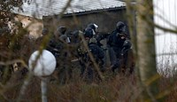 Police assault the building holding two terror suspects in Dammartin-en-Goele, some 40 kilometres north-east of Paris, on Jan. 2015.