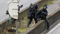 French police close in on suspected killers, new shoot-out in Paris