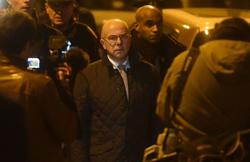 French Interior Minister Bernard Cazeneuve arrives to speak at the offices of the French satirical newspaper Charlie Hebdo on Jan 7 in Paris. According to Cazeneuve, at least 1,200 french citizens are or have been involved in the Syrian war.