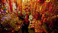 Shoppers look at lunar new year decorations in the days leading up to Tet Lunar New Year in Hanoi, Vietnam.