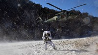 South Korean special warfare forces move to a position after abseiling from a helicopter during a winter drill in Pyeongchang, some 180 kilometers east of Seoul, on Thursday, Jan 8, 2015.