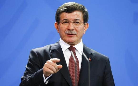 urkish Prime Minister Ahmet Davutoglu speaks to media after his meeting with German Chancellor Angela Merkel at the Chancellery in Berlin, January 12, 2015.