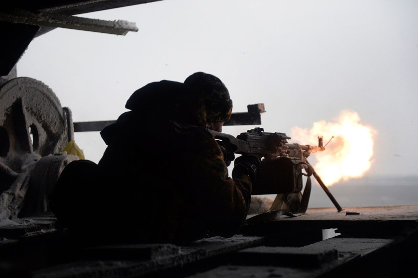 An Ukrainian Right Sector batallion volunteer fires a machine gun from his position near the eastern Ukrainian village of Pisky, in the northeastern Donetsk region, at pro-Russian separatists near the Donetsk airport, on Jan. 3, 2015.