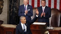 President Obama waves before delivering his State of the Union address.