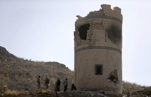 Houthi fighters stand near a damaged guard post at a Presidential Guards barracks they took over on a mountain overlooking the Presidential Palace in Sanaa January 20, 2015.