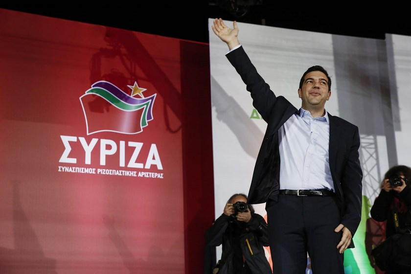 Alexis Tsipras, leader of the Syriza party, waves to supporters during a pre-election rally at Omonoia square in Athens, Greece, on Jan. 22, 2015.
