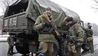 Pro-Russian separatists stand next to a military truck in Donetsk, eastern Ukraine, January 21, 2015.