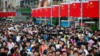 Crowds walk down Nanjing Road East in Shanghai, China
